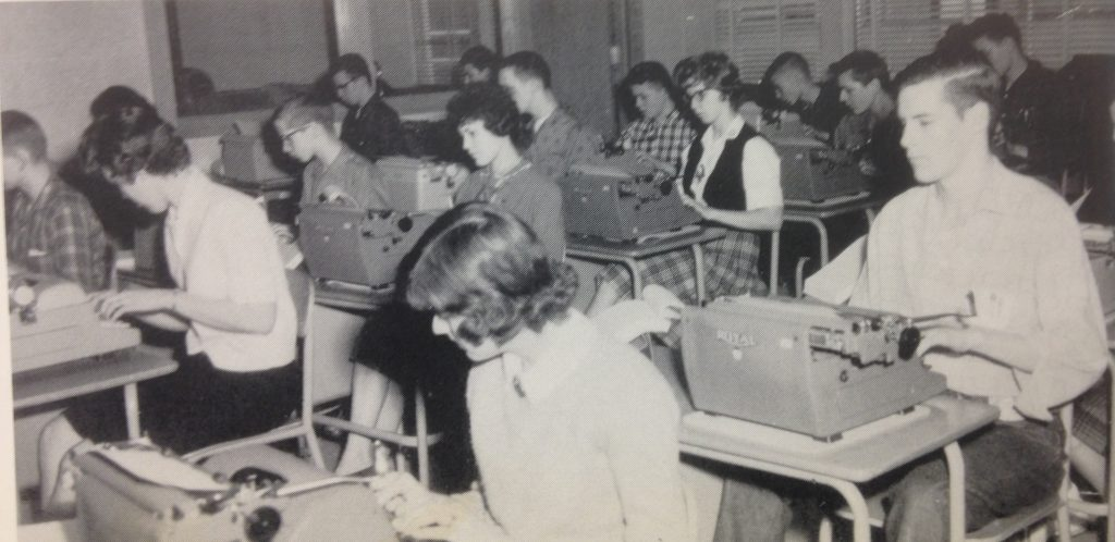 Photos of students in 1958 using typewriters.