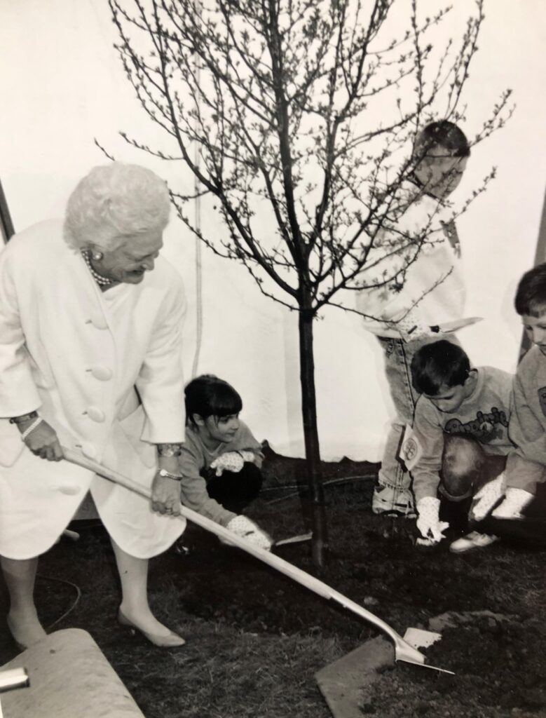 First Lady Barbara Bush planting a tree with students from Prairie View Elementary School.